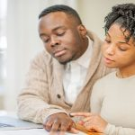 Couple Balancing a Joint Checking Account