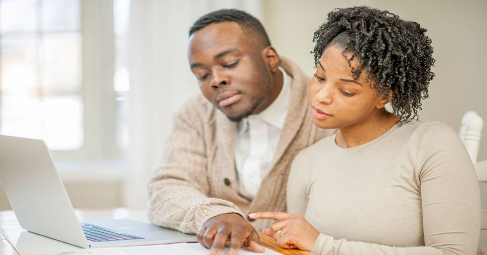 Couple Balancing a Joint Checking Account