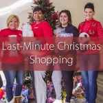 Ladies holding Christmas presents in front of a Christmas tree