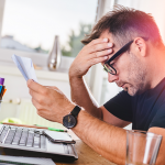 Man Stressed About Overdrawing His Checking Account