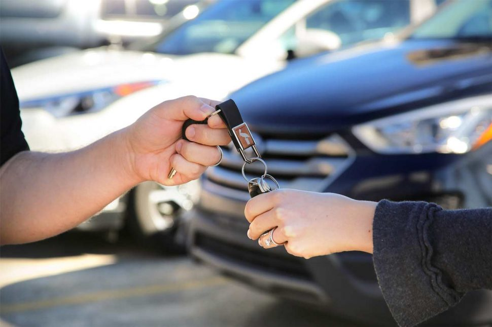 Vehicle trade-in on car lot, passing off keys